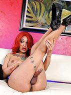 Redhead mistress. Redhead Adriana jerks her huge dick
